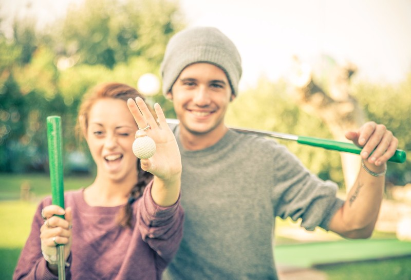 bigstock-Couple-Playing-Golf-78380873