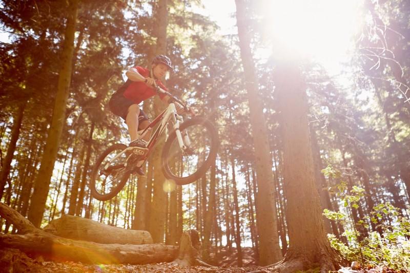 bigstock-Mid-Air-Shot-Of-Man-Riding-Mou-87399608