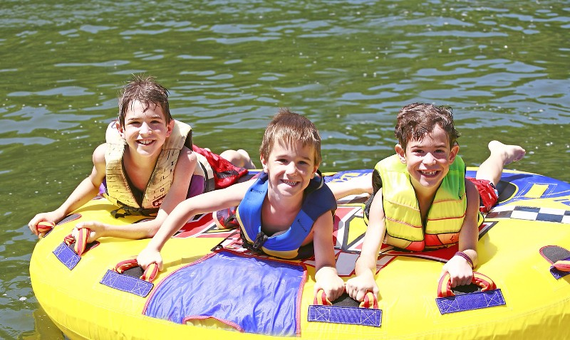 bigstock-Three-Boys-Tubing-1882650